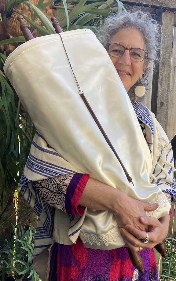 Chaya holding a Torah